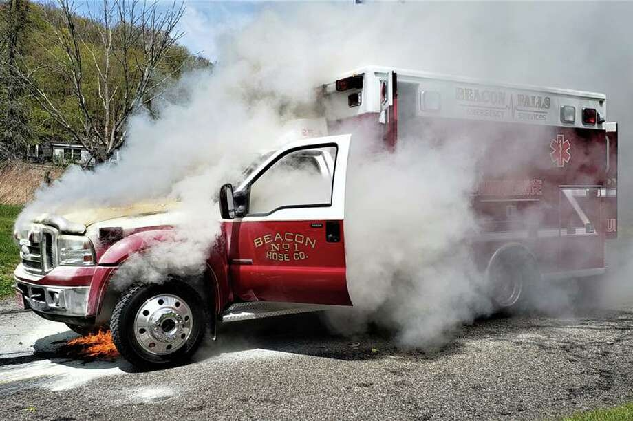 An ambulance of the Beacon Hose Co. caught fire Monday afternoon on May 11, 2020 in Beacon Falls while taking a patient to the hospital. No one was injured. Photo: Beacon Hose Co. No. 1 Photo