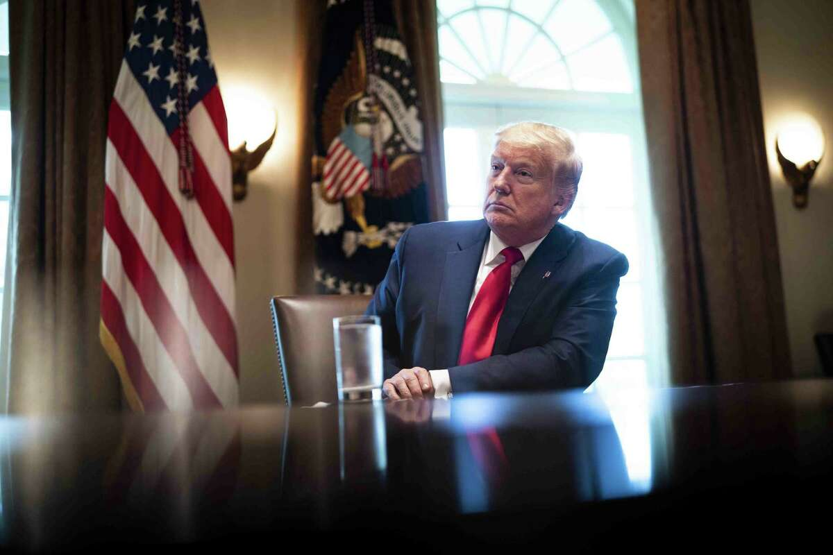 President Donald Trump listens while participating in a roundtable meeting with energy sector chief executive officers in the Cabinet Room of the White House last month. So far, his efforts to boost the struggling oil and gas industry have not paid off.