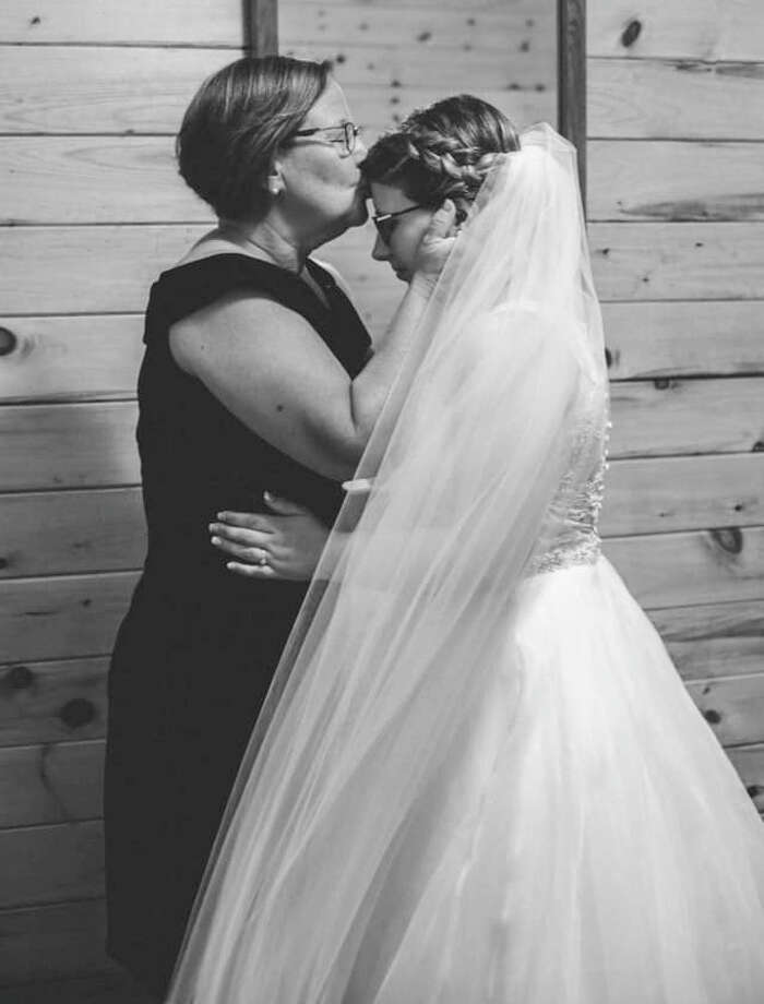 """My momma (Leah) and me on my wedding day.""