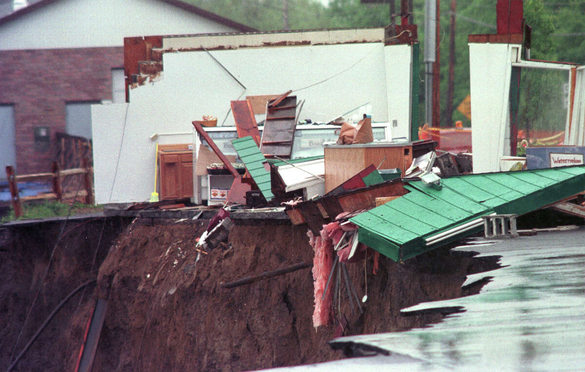 Debris from a produce store rests near the edge of a landslide near Delaware Avenue on May 19, 2000. (Steve Jacobs/Times Union)