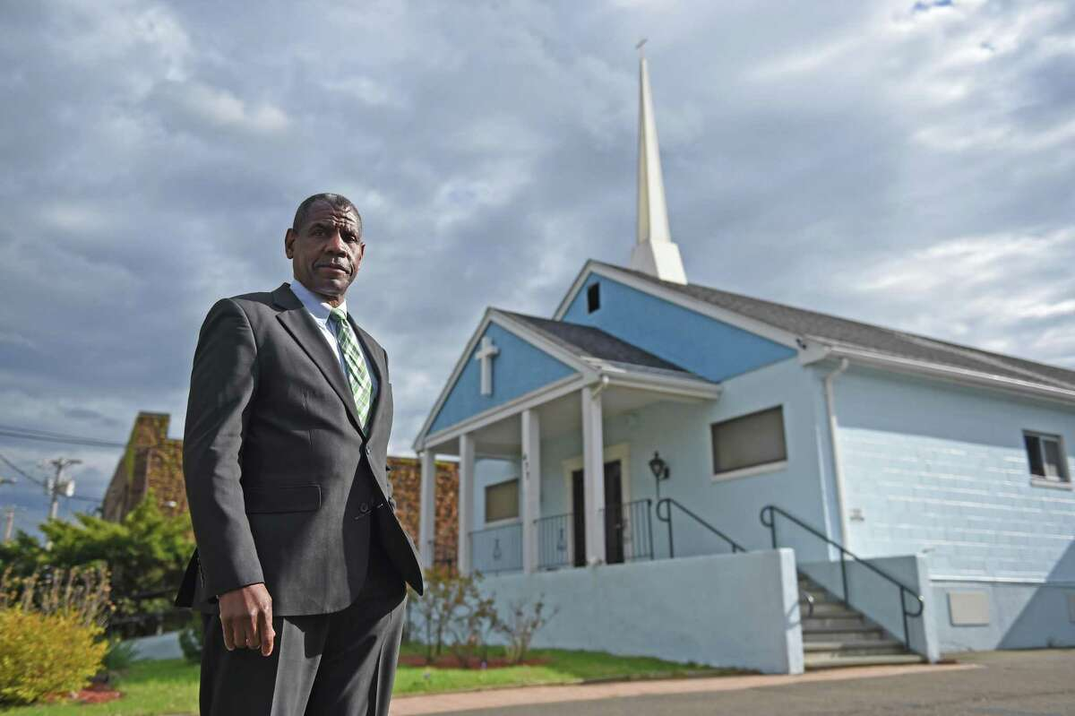 Pastor Carl McCluster stands outside of his church, Shiloh Baptist in Bridgeport.