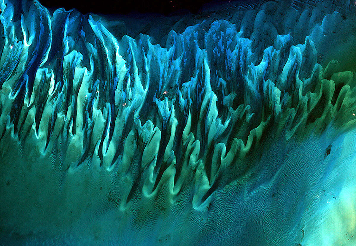 Ocean Sand, Bahamas: Serge Andrefouet's 2001 satellite image of the sands and seaweed in the Bahamas was taken using the Enhanced Thematic Mapper plus instruments aboard the Landsat 7 satellite.