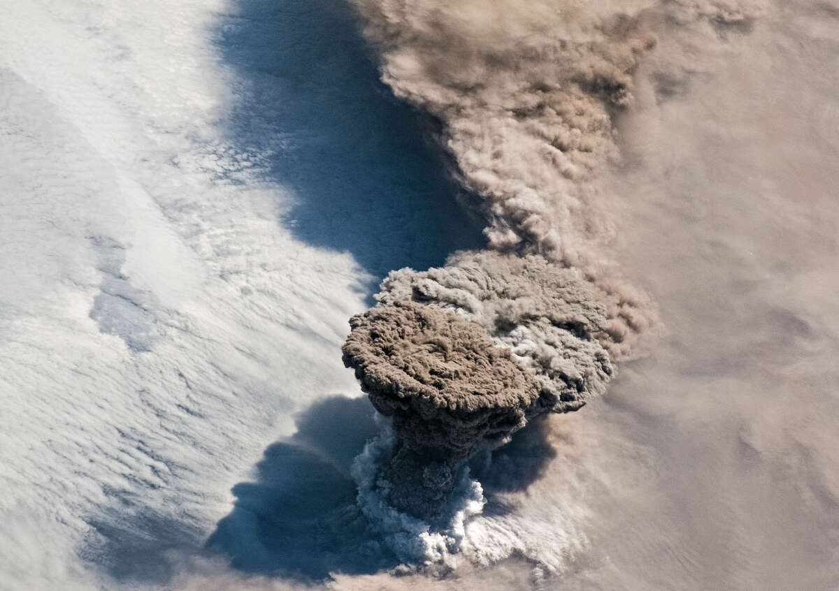 Raikoke Volcano: On June 22, astronauts captured this photograph of the volcanic plume rising and then spreading out in the umbrella region of Raikoke Volcano located on the Kamchatka Peninsula.Source: Earth Observatory/NASA.