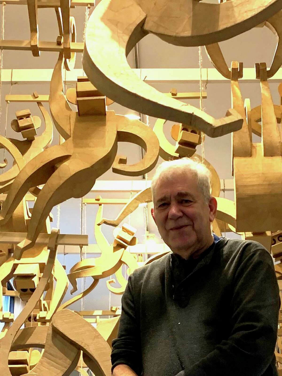 Sculptor and woodcut artist James Grashow of Redding with his cardboard hanging monkeys installation.