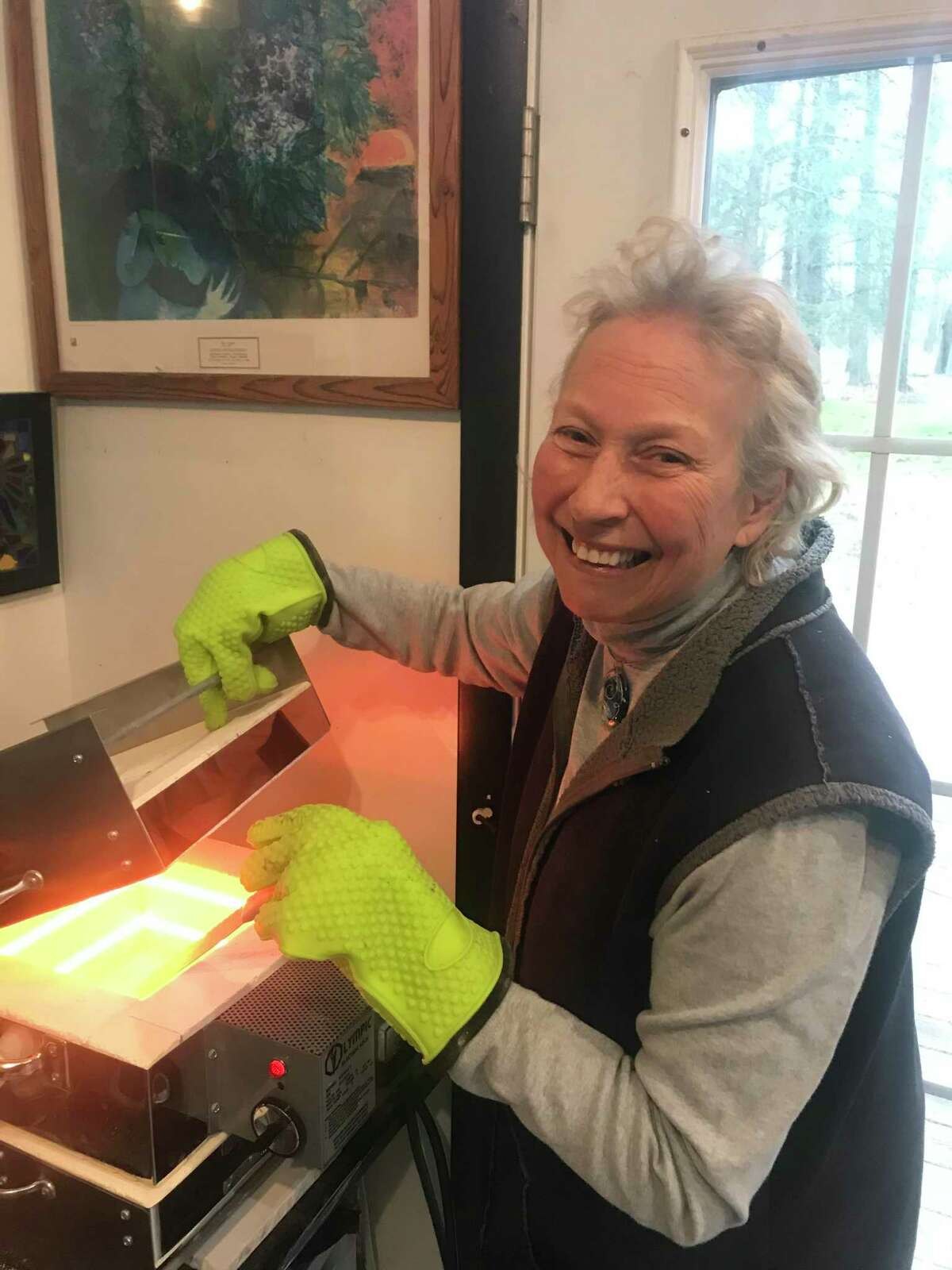 New Milford's Lise Weller is a glass artist who is offering her services to make memorial omi for those who lost a loved one to the coronavirus.
