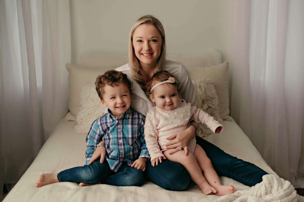 Working mom Jill Nesloney is shown here with her two children.