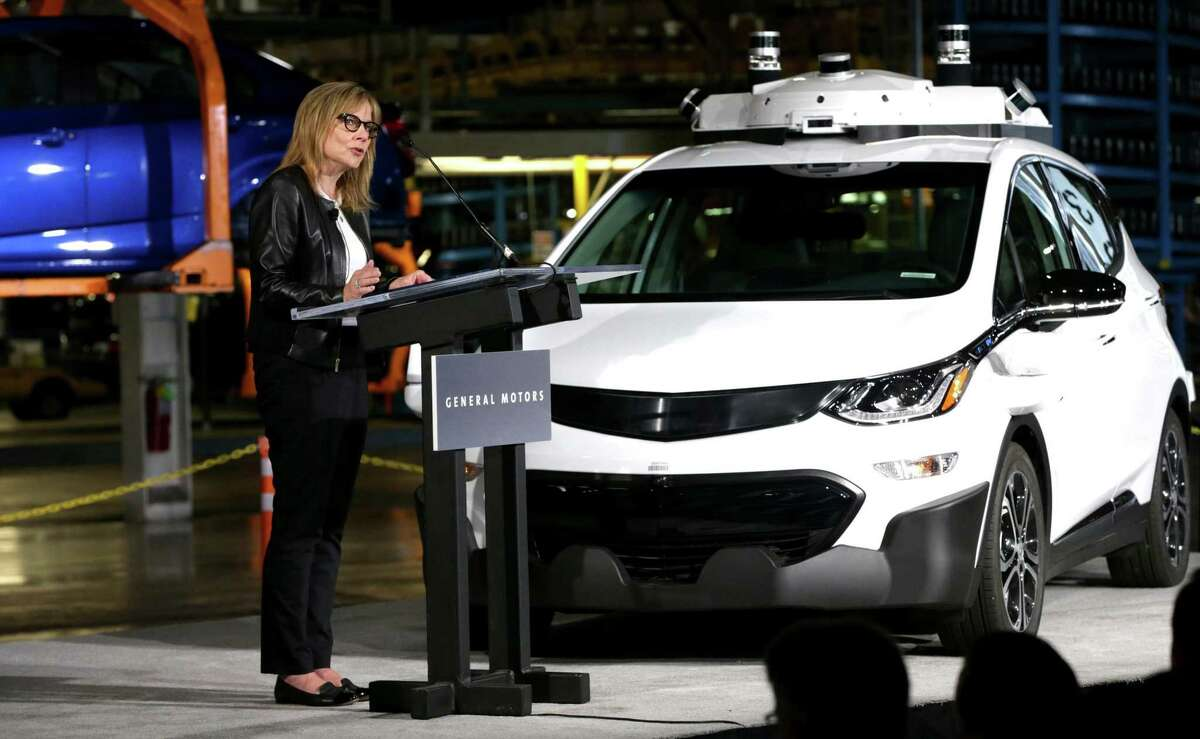Mary Barra, chairman and CEO of General Motors, talks with workers and members of the media at the Orion Assembly Plant in Orion Township, Mich., announcing that the company had completed production of 130 Chevrolet Bolt EV test vehicles equipped with its next generation of self-driving technology.