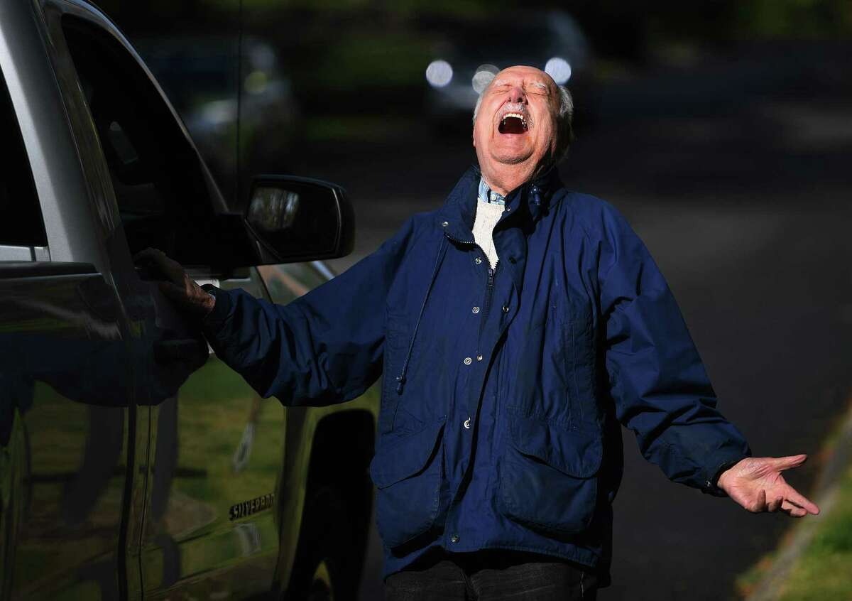 Former state representative and Korean War vet William Bevacqua reacts as he is surprised outside his Partridge Lane home with a parade for his 90th birthday in Trumbull, Conn. on Monday, May 11, 2020.