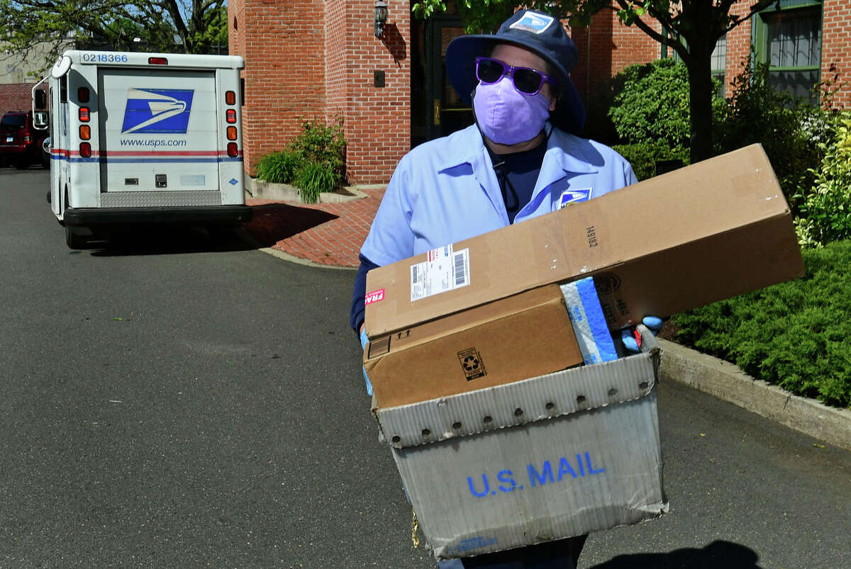 Libby Carroll, a USPS mail carrier, on her route Tuesday, May 12, 2020, in Norwalk, Conn. Carroll made protective masks with HEPA filter inserts for customers she delivers mail to each day. 3. A few letters, including one to the Bridgeport town clerk, never arrived. It's not clear what happened to the letters, not even those that were tracked through the USPS tracking feature. One Bridgeport letter still says in transit on the USPS tracking history - nearly three weeks after it was sent from a Bridgeport post office.