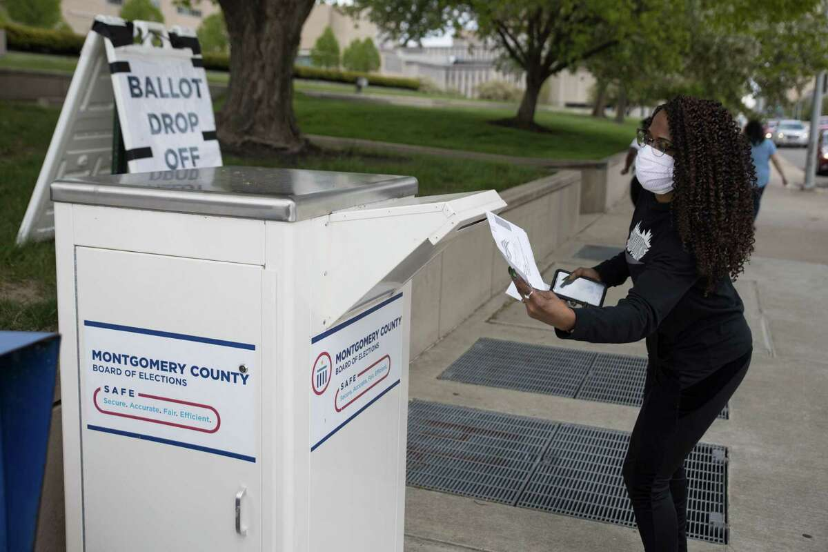 An Ohio voter drops off her ballot at the Board of Elections in Dayton, Ohio on April 28, 2020. - On March 17, 2020 Governor Mike DeWine and Ohio Department of Health Director Amy Acton delayed Ohio primaries over coronavirus concerns. The primaries were changed exclusively to a vote-by-mail system to reduce chances of virus spread. (Photo by Megan JELINGER / AFP) (Photo by MEGAN JELINGER/AFP via Getty Images)