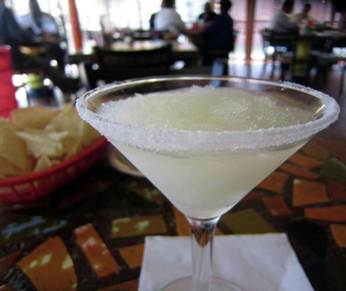 Spanish Village serves its slushy style margarita in a martini glass.