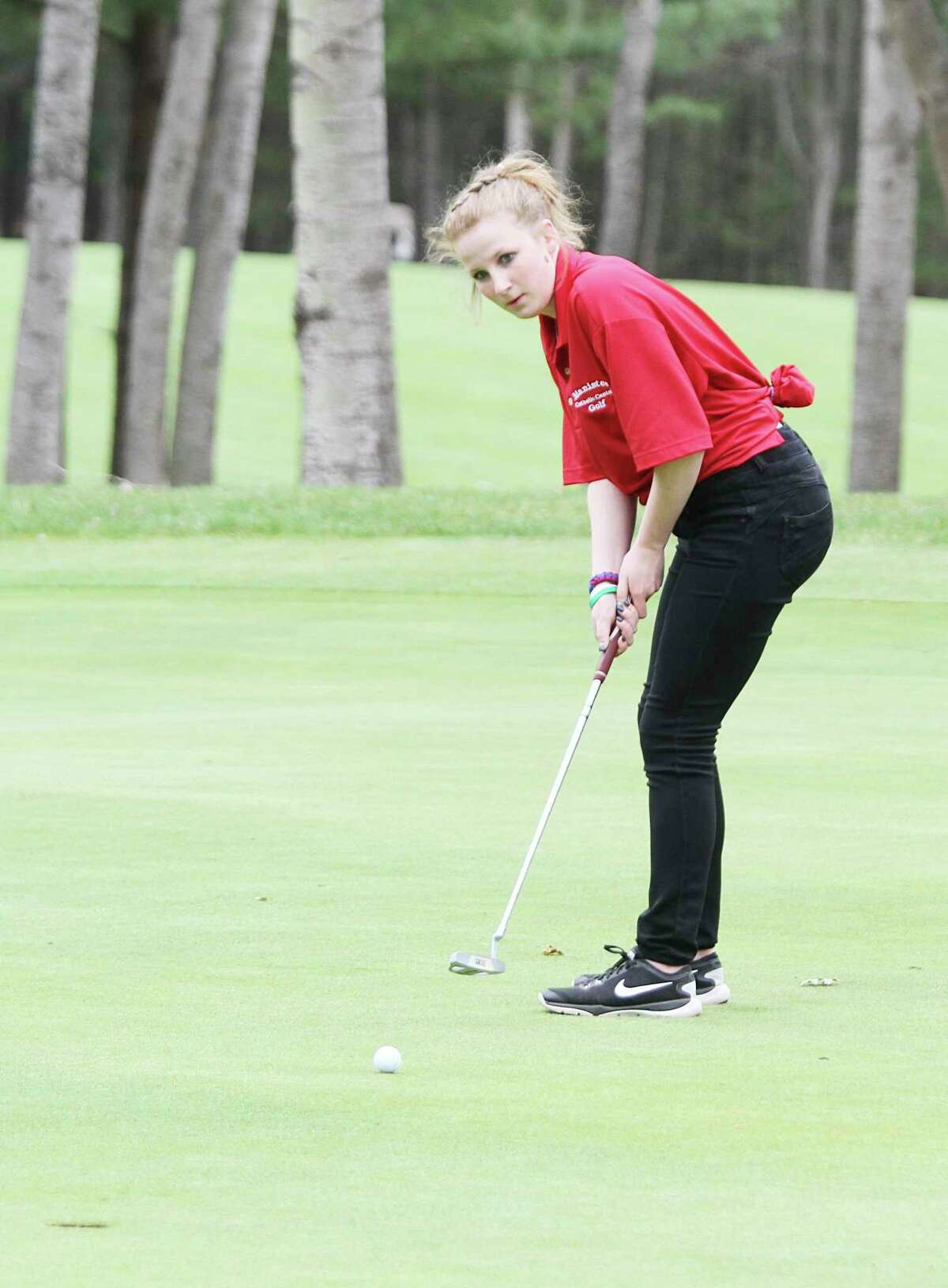 Manistee Catholic Central's Mallory Meikle was one of several Sabers looking to make strides on the golf course this spring. (News Advocate file photo)