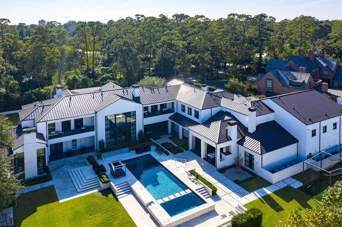 After $5 million was shaved from its Dec. 2019 listing price, the modern estate located at 9030 Sandringham Drive is now available for a whopping $19,950,000.