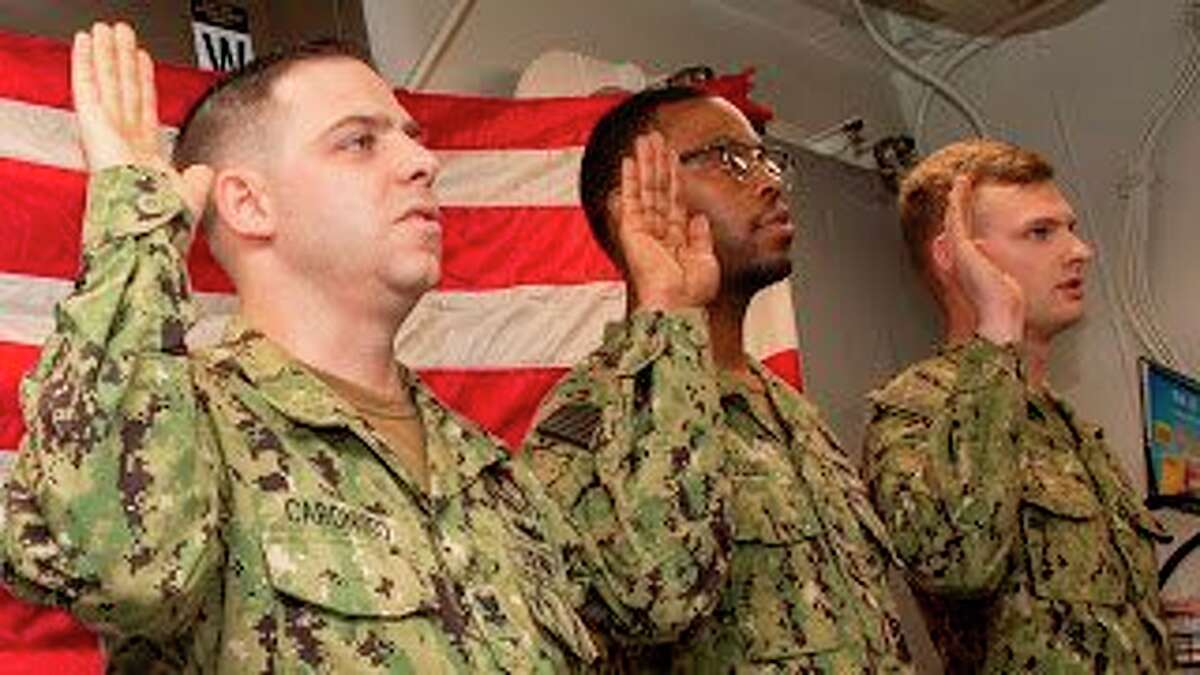 (Far right) Petty Officer 2nd Class Zachary Borst reenlisted in the U.S. Navy during a ceremony held onboard USS James E. Williams. Borst is a 2015 graduate of Reed City High School. (Submitted photo)