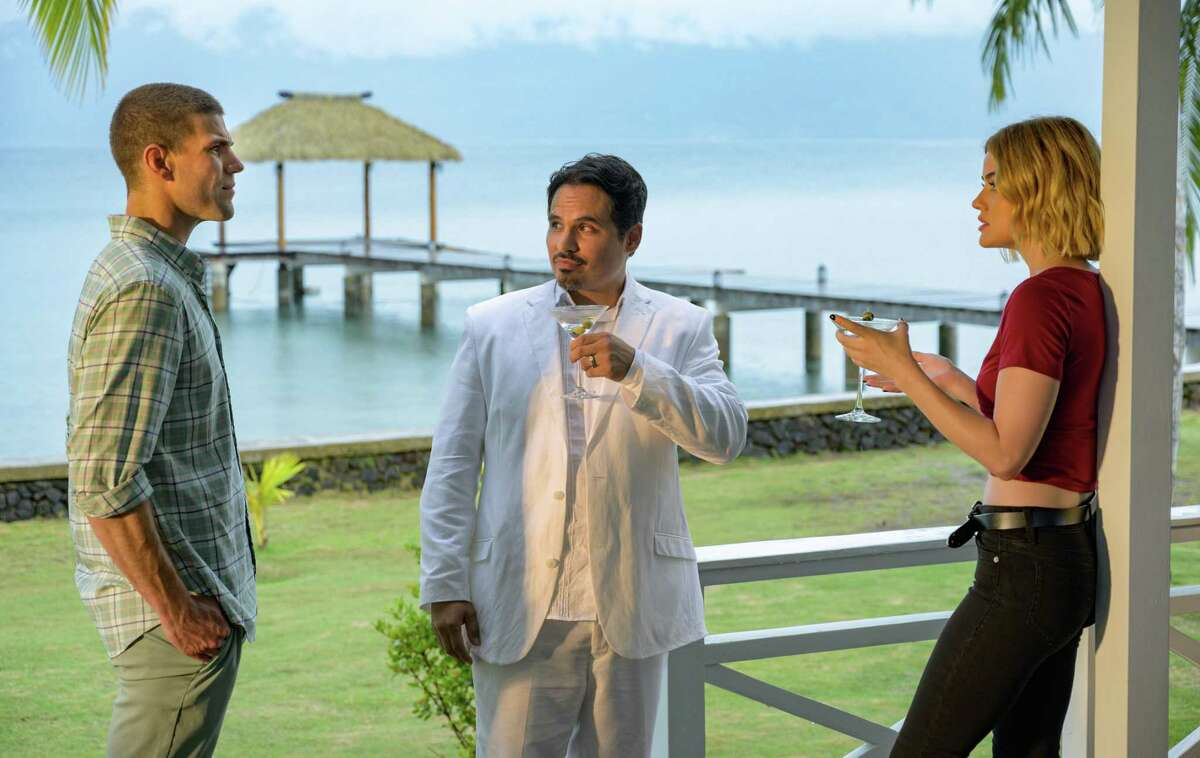 Mr. Roarke (Michael Peña, center) welcomes guests played by Austin Stowell and Lucy Hale to Fantasy Island.
