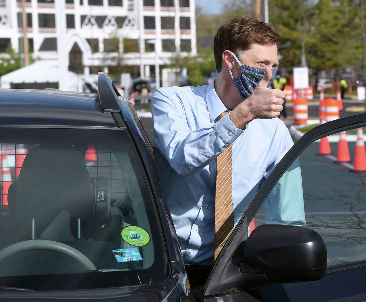 New Haven Mayor Justin Elicker gives the thumbs-up after testing negative for COVID-19 at the CVS test site on Sargent Drive in New Haven on May 12, 2020.
