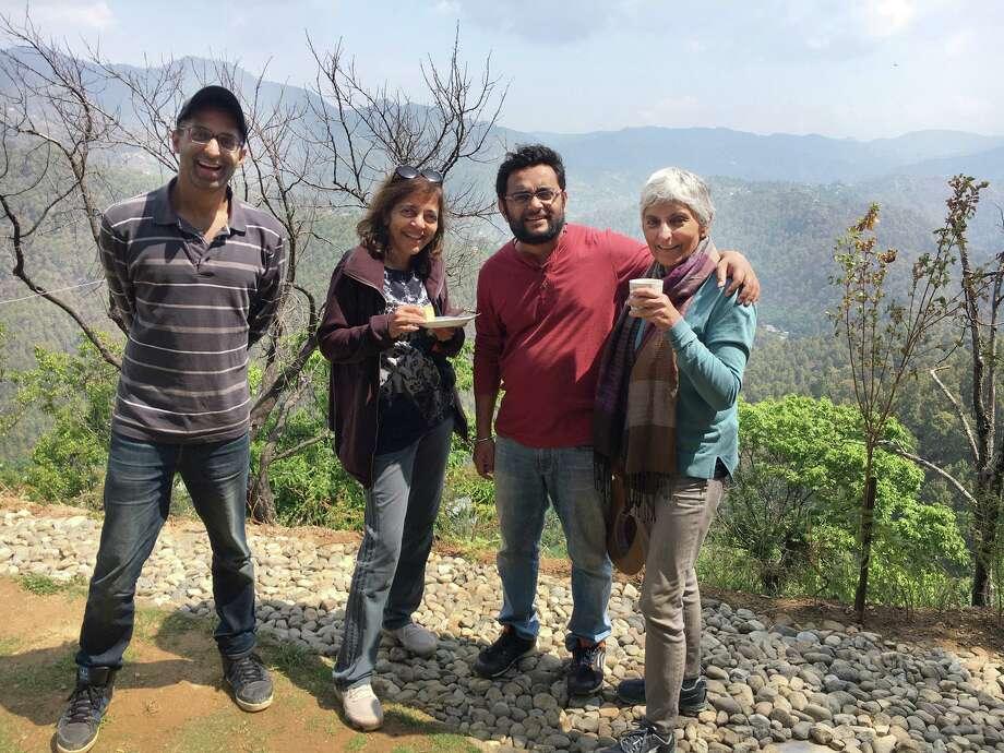 Views of Uttarakhand, India from the kitchen patio, enjoying a cup of tea and snacks. From left, Rahul Saksena, Sangeeta Srivastava, Udai Srivastava and Deepika Saksena. Photo: Contributed Photo / Connecticut Post