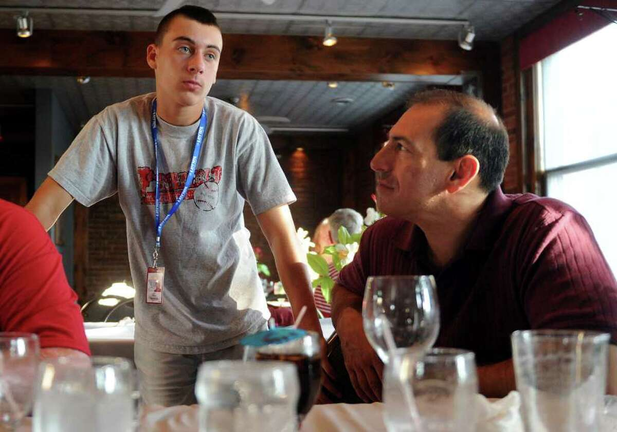 Nick Nardone, left, talks to his mother Mary (not pictured) and father, John, right, during a gathering for the Fairfield American little league team and supporters at the Bullfrog Brewery in Williamsport, Penn., after the New England Champions defeated the Northwest in their game Friday, August 20, 2010.