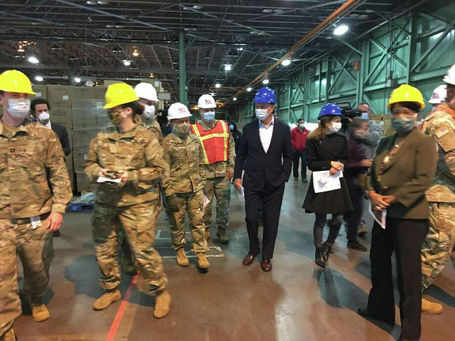 Gov Ned Lamont on Tuesday morning spoke in a New Britain warehouse with members of the Connecticut National Guard, who are managing million of pieces of personal protective equipment. Photo: Ken Dixon / Hearst Connecticut Media