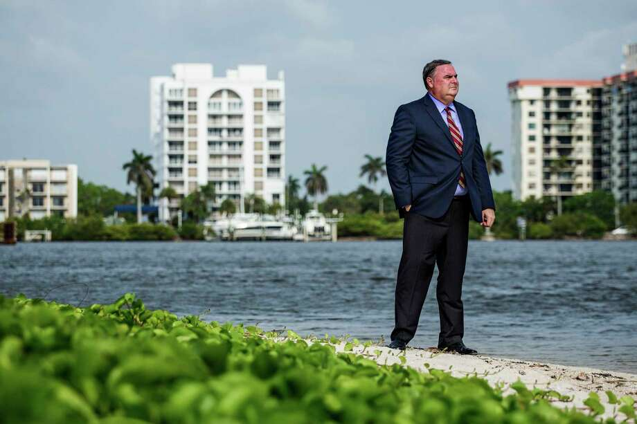 Attorney Reginald Stambaugh stands along the waterway near the Mar-a-Lago Resort. Stambaugh is the lawyer representing the family of Mar-a-Lago neighbor Nancy Demoss, who is opposing a new boat dock that would be built at Mar-a-Lago. Photo: Photo For The Washington Post By Scott McIntyre / Scott McIntyre for The Washington Post