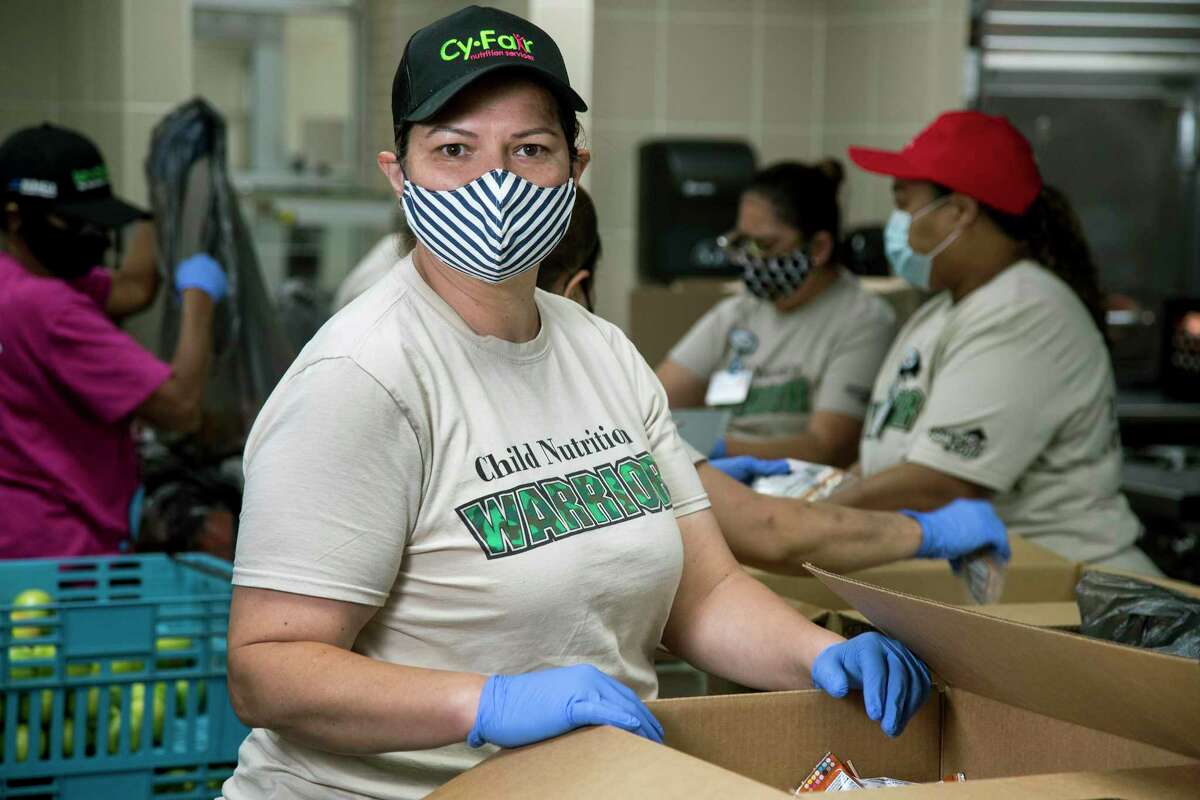 Gladys Navarro, the nutrition services general manager at Cypress Lakes High School in Cy-Fair ISD, has throughout the shutdown come to the school to help provide hundreds of students with curbside meals. Amid the pandemic, Navarro and a rotating cast of six employees spend each weekday packaging and delivering between 700 and 1,000 meals.