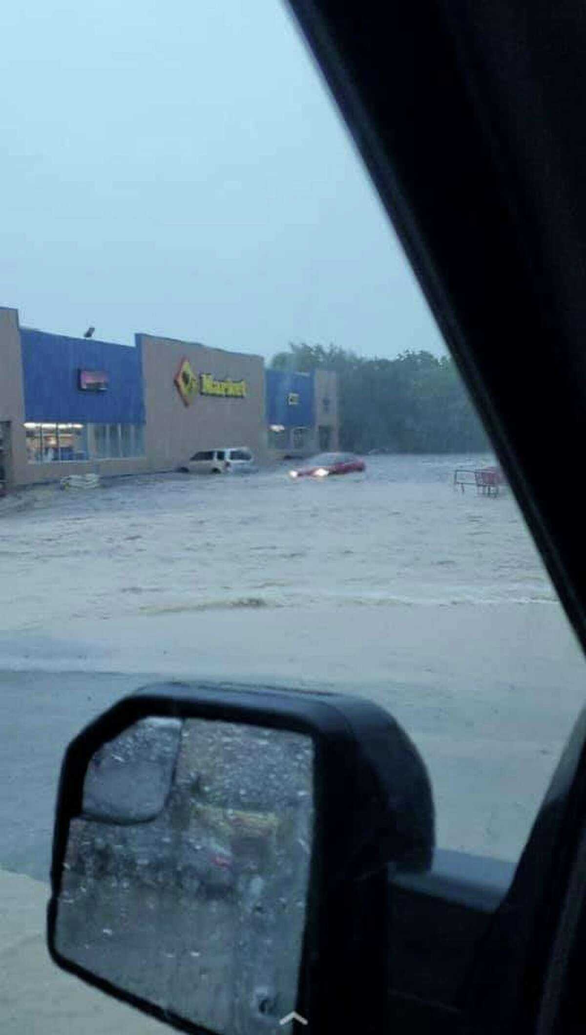 Troy Miller shared this photo with mySA showing a flooded parking lot at a Lowe's Market in Startzille, just outside of Canyon Lake, on May 12, 2020.