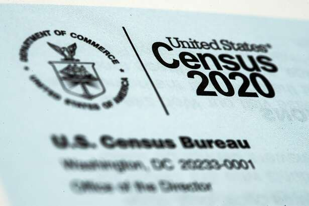FILE - This March 19, 2020, file photo, shows a 2020 census letter mailed to a U.S. resident in Glenside, Pa. Just how badly has the new coronavirus impacted life in the U.S.? The U.S. Census Bureau, along with five other federal agencies, will try to answer that question with a new experimental, weekly survey that just got approved earlier this week. (AP Photo/Matt Rourke, File)
