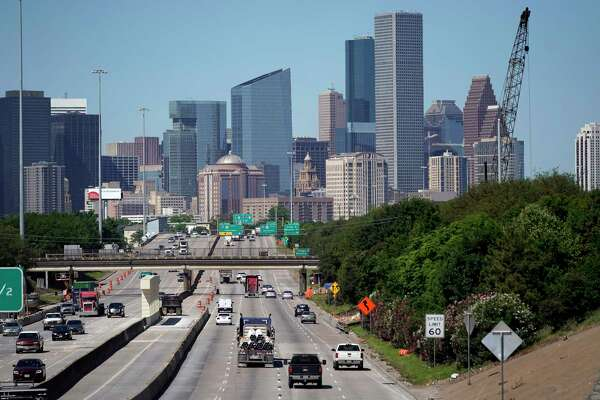 Traffic moves along Interstate 10 near downtown Houston two weeks ago. As Texas reopens its economy, traffic and air pollution are returning.