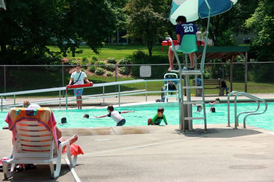 In this file photo, children enjoy the warm weather and sunshine at the Charles E. Fairman pool in Big Rapids. Due to the extended stay-at-home order, Big Rapids City Manager Mark Gifford addressed the city commission Monday about possibly closing the pool for the 2020 season. A survey asking residents to voice their thoughts on the matter can be found on the city of parks and recreations Facebook page, as well as the city's Facebook page. (Pioneer file photo)