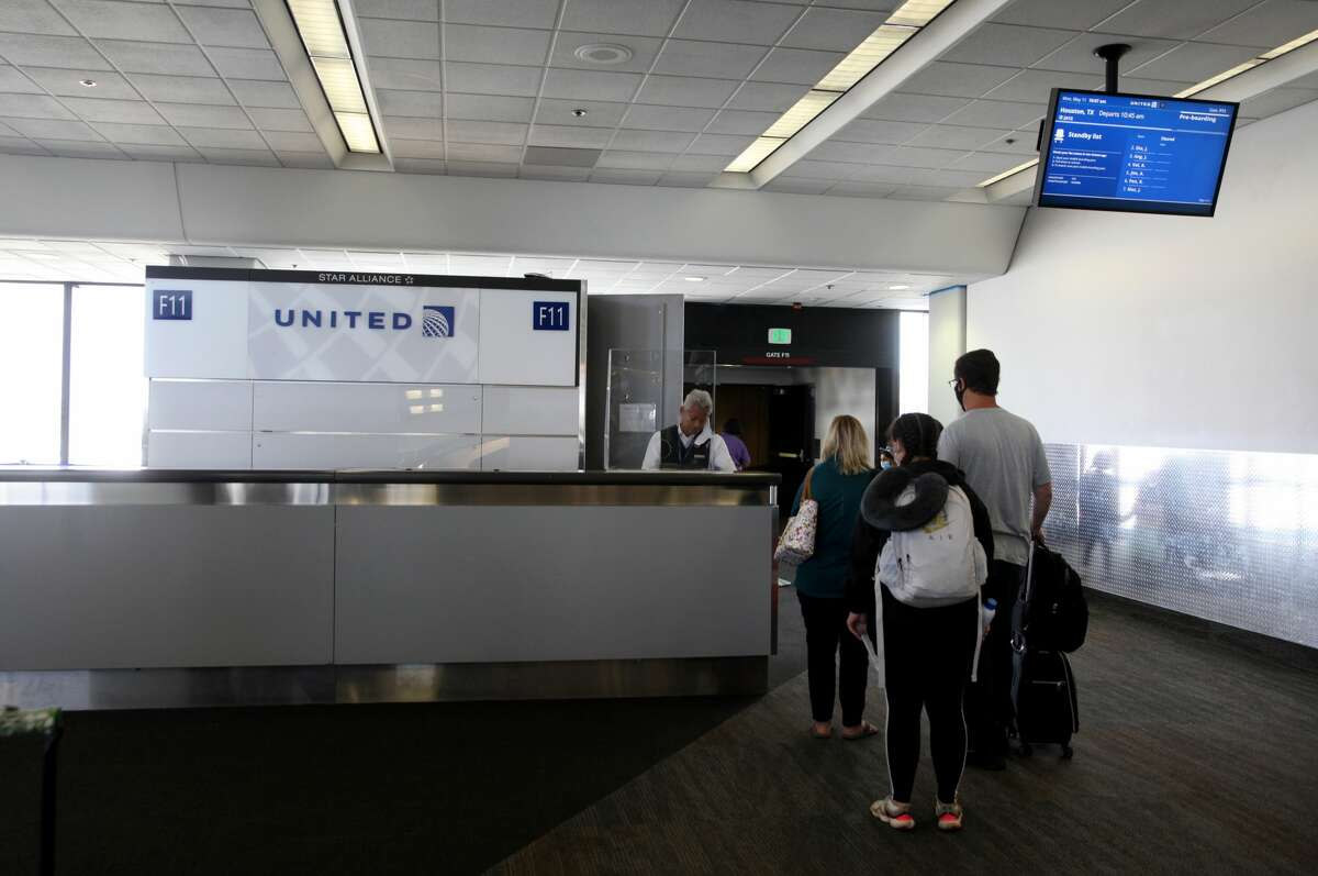 Passengers board a United Airlines flight to Houston, Texas at San Francisco International Airport on May 11, 2020 in San Francisco, California. Air travel is down as estimated 94 percent due to the coronavirus (COVID-19) pandemic, causing U.S. airlines to take a major financial hit with losses of $350 million to $400 million a day and nearly half of major carriers airplanes are sitting idle.