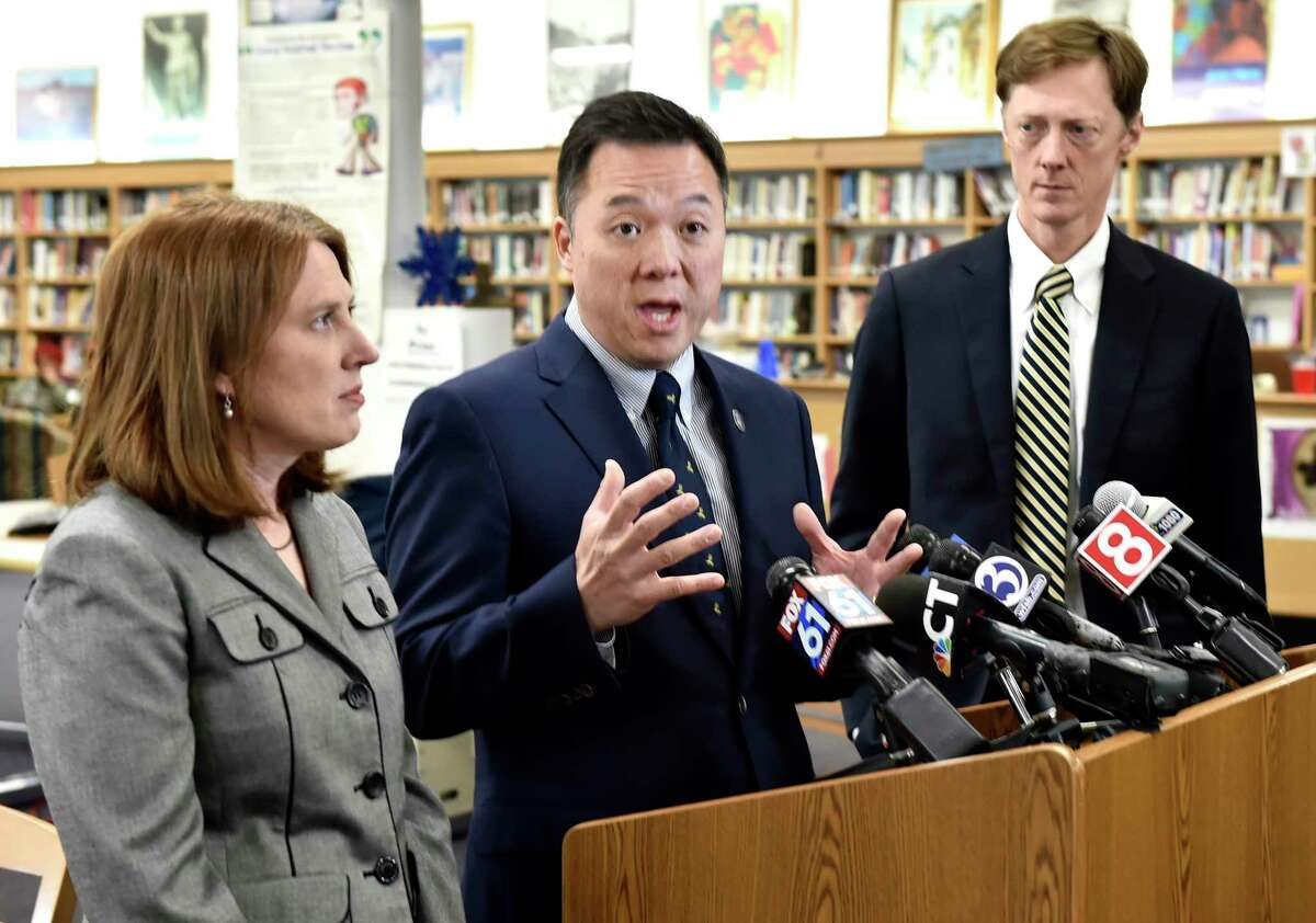 Connecticut Attorney General William Tong, center, in February 2020 alongside Michelle Seagull, commissioner of the Connecticut Department of Consumer Protection; and New Haven Mayor Justin Elicker.