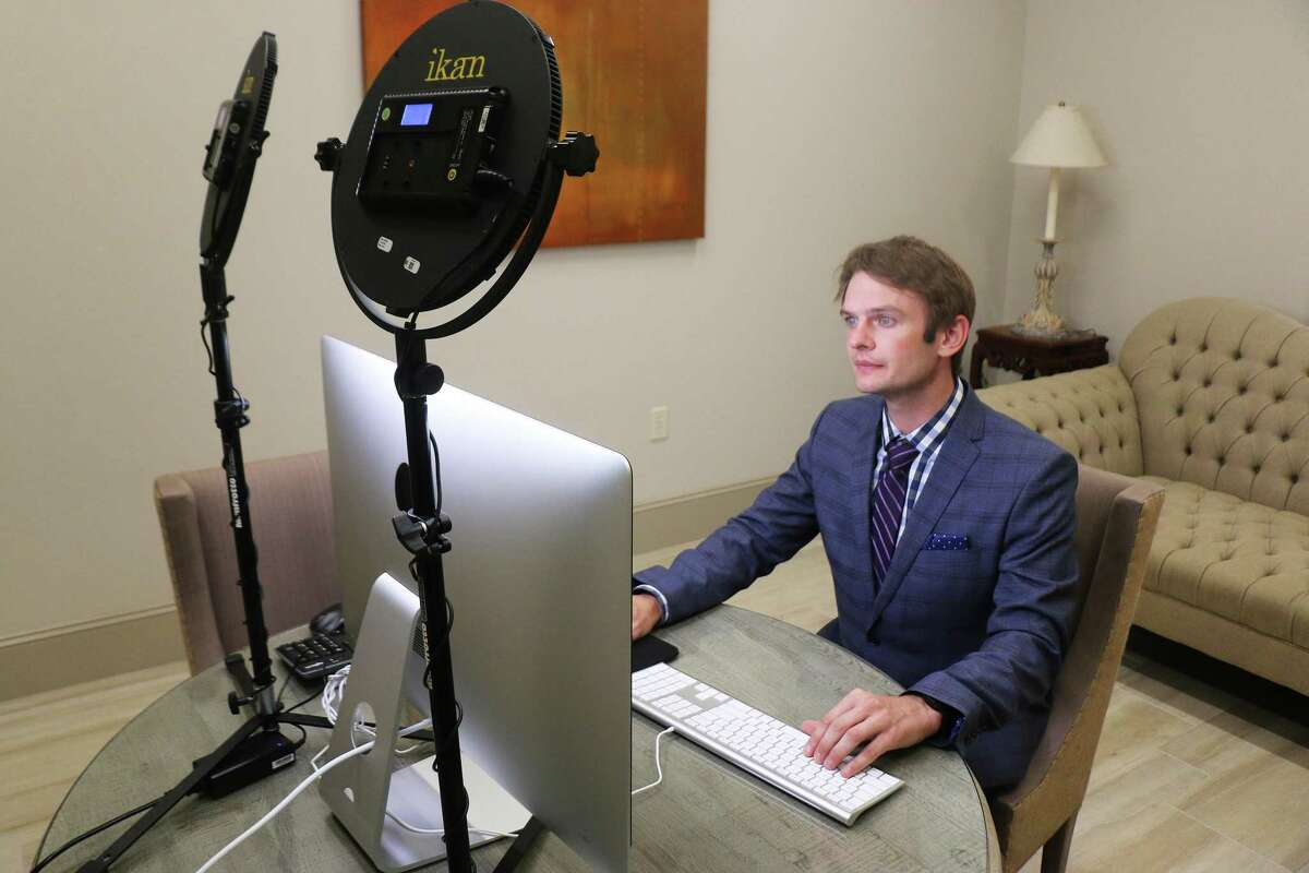 Jess Fields, Jr. sits in one of the interview rooms at the Rosewood Funeral Home in Atascocita that is set up with a computer and special lighting so he and other funeral directors can discuss funeral arrangements with families remotely. Fields, Jr. assisted his father in acquiring and overseeing the technology updates.