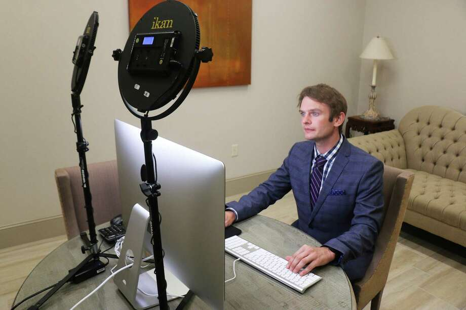 Jess Fields, Jr. sits in one of the interview rooms at the Rosewood Funeral Home in Atascocita that is set up with a computer and special lighting so he and other funeral directors can discuss funeral arrangements with families remotely. Fields, Jr. assisted his father in acquiring and overseeing the technology updates. Photo: David Taylor / Staff Photo