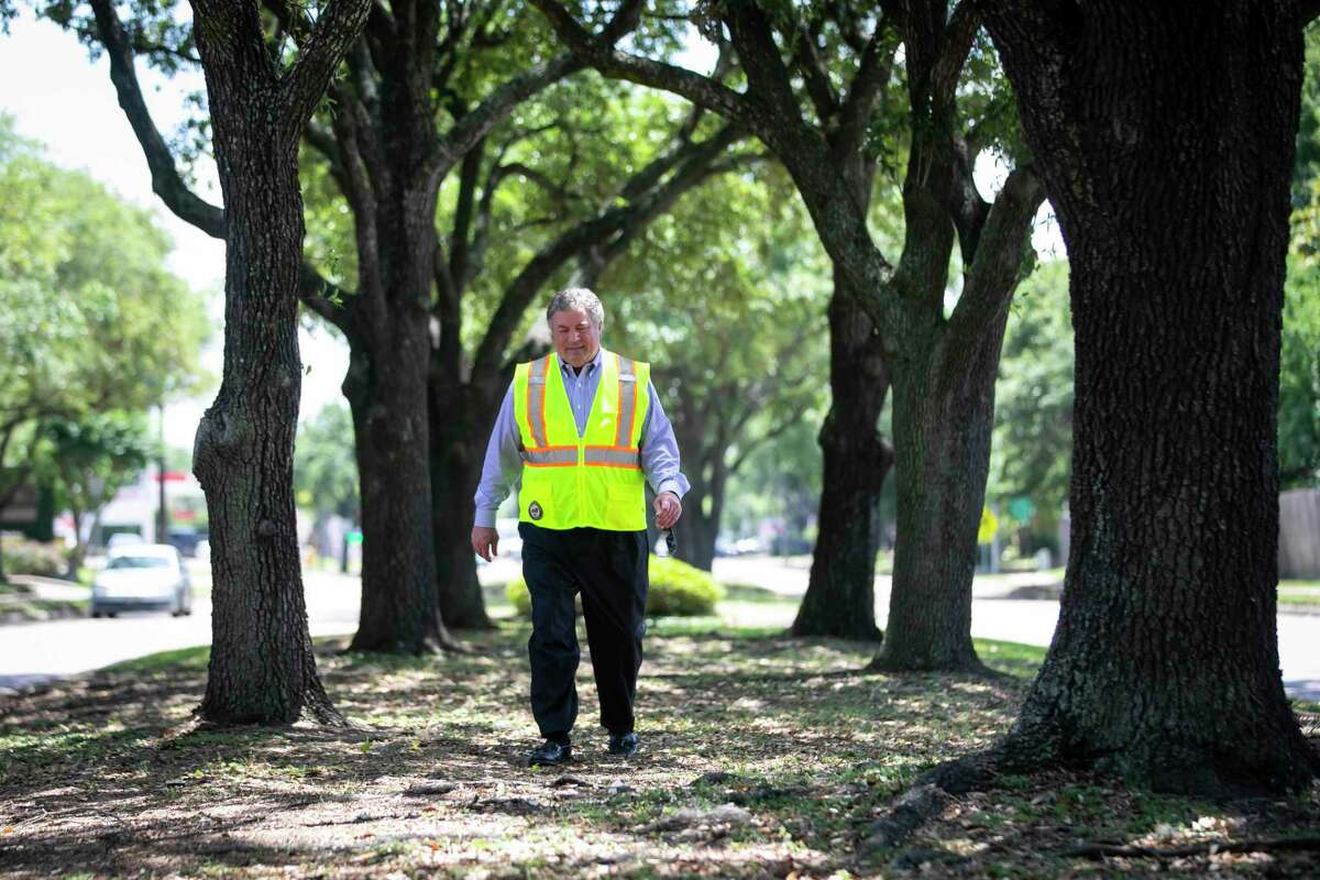 Houston District G Councilman Greg Travis walks down a tree-line median along Kirkwood near Briar Forest on May 11, 2020. A long-delayed project will rebuild the street and drainage, but preserve most of the street's trees.