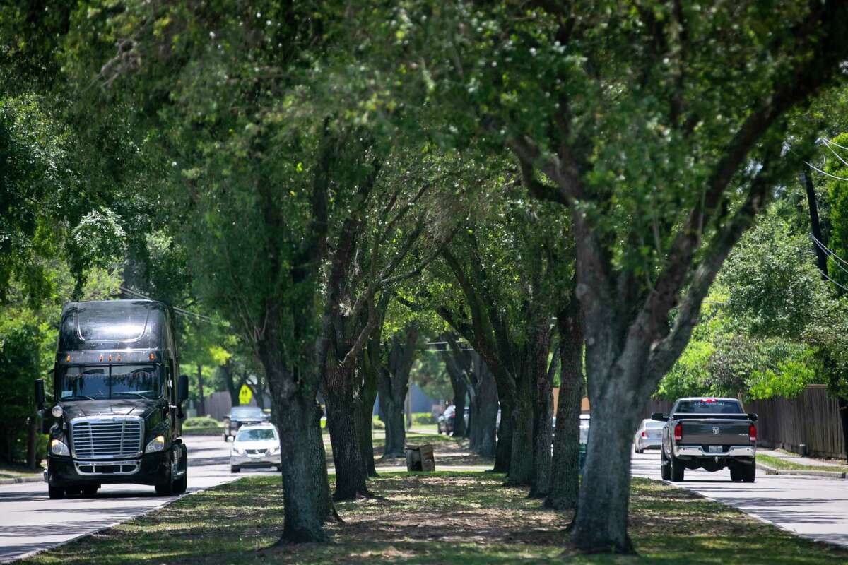 Vehicle traffic passes next to the tree-lined median along Kirkwood on May 11, 2020.