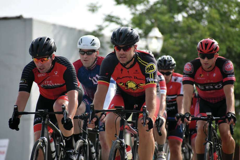 Cyclists fly down St. Louis Street on their way to Main Street during the Rotary Criterium Festival in downtown Edwardsville in 2019. Photo: Matt Kamp|The Intelligencer