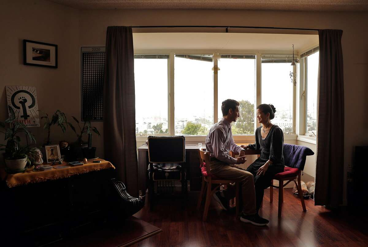 Kristina Soriano, and her husband Jonas Di Gregorio in their apartment in San Francisco, Calif., on Sunday, April 12, 2020. The couple have received requirements including providing access to personal financial records, signing off on having their employers contacted to prove salaries and such to be eligible for rent deferments during the coronavirus shutdown.