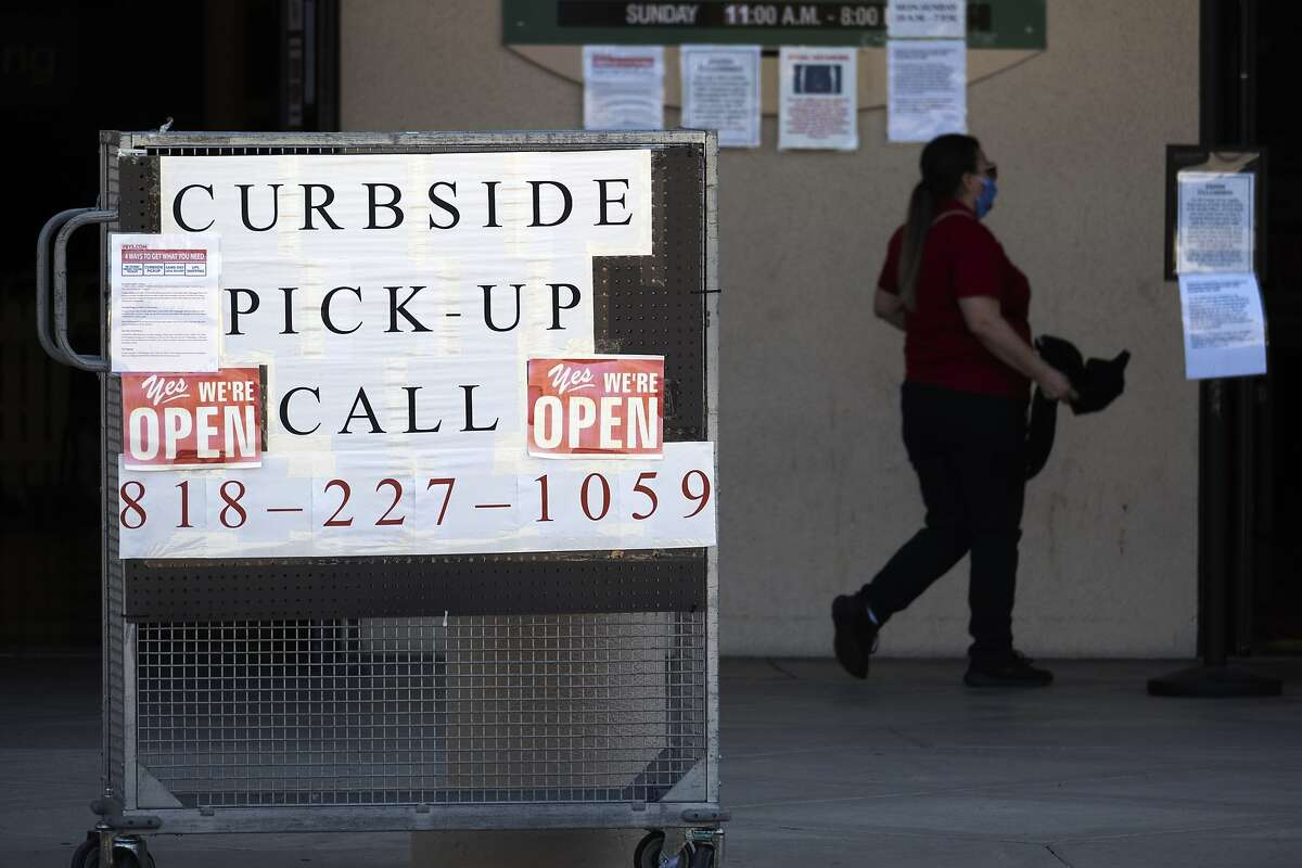 A curbside pick-up sign is seen outside a Fry's Electronics shop in the Woodland Hills section of Los Angeles on Saturday May, 2, 2020. (AP Photo/Richard Vogel)