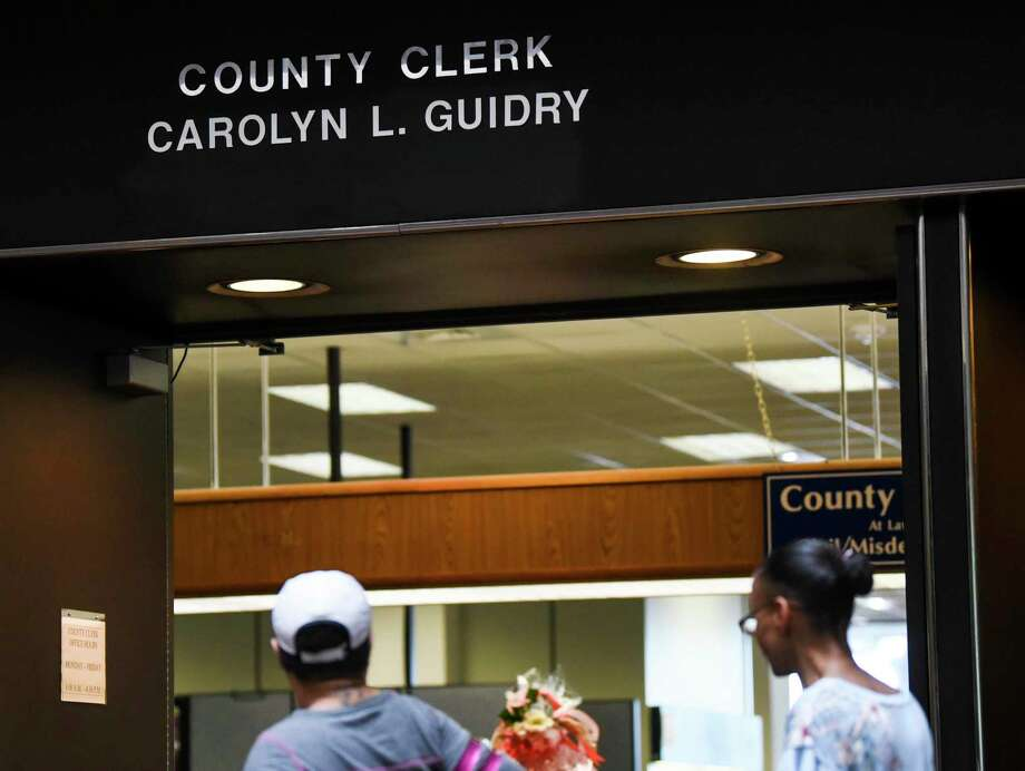 People enter the Country Clerks office in the Jefferson County Courthouse on Tuesday. Photo taken on Tuesday, 04/09/19. Ryan Welch/The Enterprise Photo: Ryan Welch / Ryan Welch/The Enterprise / ©Ryan Welch