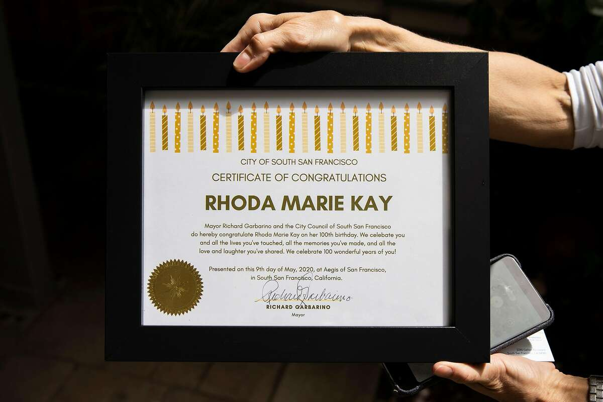 A certificate of congratulations that was presented to Rhoda Marie Kay by South San Francisco mayor Richard Garbarino on Saturday, May 9, 2020, in South San Francisco, Calif. Kay turned 100 years old. She was celebrated by her family and friends at Aegis Living, the assisted living facility where she resides. Amid the coronavirus pandemic, she did not leave the facility and saw her friends and family through a window.