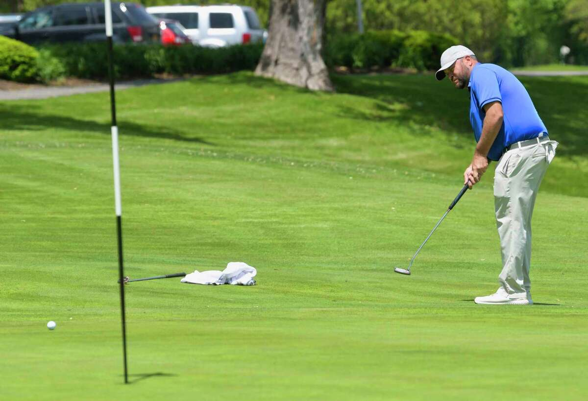 Scott Berliner watches his putt roll on the 15th green during the final round of the Northeastern New York PGA Stroke Play Championship at Wolferts Roost Country Club on Wednesday, May 22, 2019, in Albany, N.Y. (Paul Buckowski/Times Union)