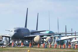 FILE - In this April 7, 2020, file photo, U.S. Air Force KC-46 tankers being built by Boeing sit parked at the Paine Field airport in Everett, Wash. Boeing failed to sell a single commercial airplane but saw orders for 108 planes canceled in April as a sharp drop in air travel erased any demand among airlines for new jetliners. It marked the second month this year in which Boeing received no orders, a fate that would have seemed impossible not long ago. (AP Photo/Ted S. Warren, File)