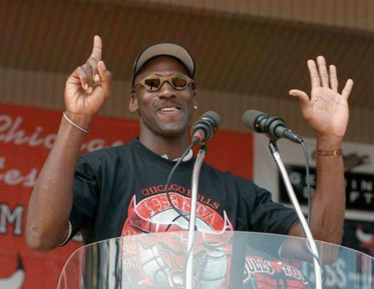 Michael Jordan holds up six fingers for each championship of the Chicago Bulls dynasty, on June 16, 1998. (Chuck Berman/Chicago Tribune/TNS)