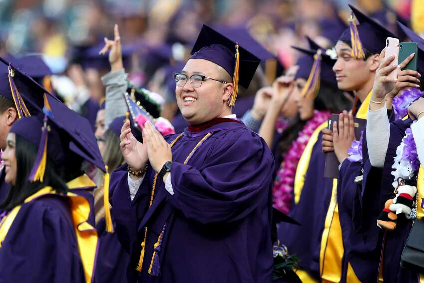 SAN FRANCISCO, CALIFORNIA - MAY 28: Graduates of the Class of 2019 applaud after House Speaker Nancy Pelosi (D-CA) delivered her speech during the San Francisco State University commencement ceremony at Oracle Park, in San Francisco, Calif., on Tuesday, May 28, 2019.