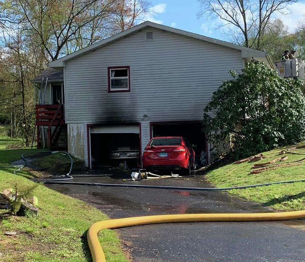 Firefighters quickly extinguished a garage fire at a Woodcrest Road home in Seymour, Conn., on Monday, May 11, 2020.