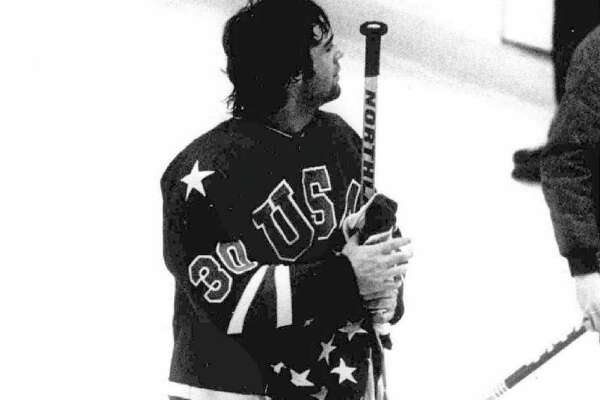 U.S. goalie Jim Craig holds the American flag after winning the gold medal at the 1980 Olympics.