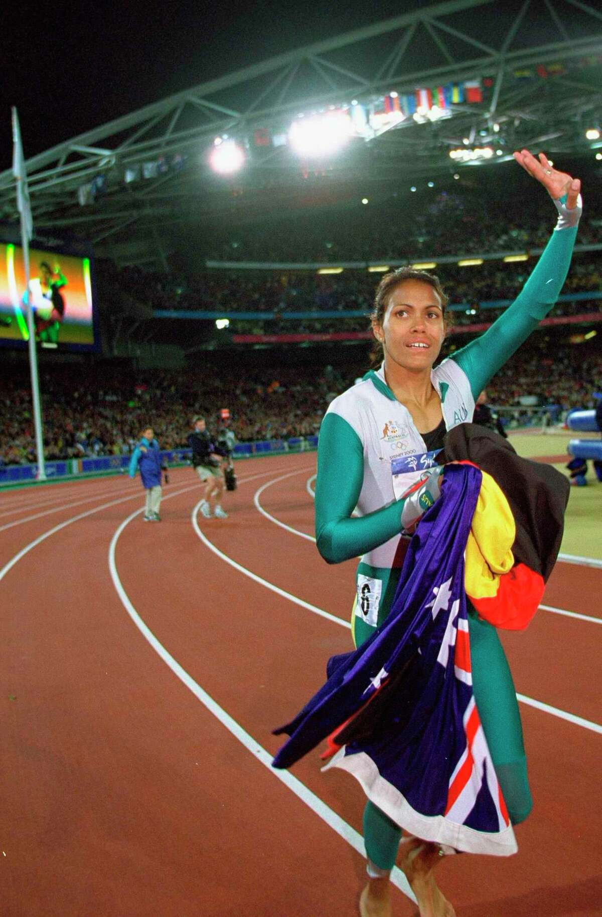 25 Sep 2000: Cathy Freeman of Australia celebrates winning Gold in the Womens 400m Final at the Olympic Stadium on Day Ten of the Sydney 2000 Olympic Games in Sydney, Australia. Mandatory Credit: Mike Powell /Allsport