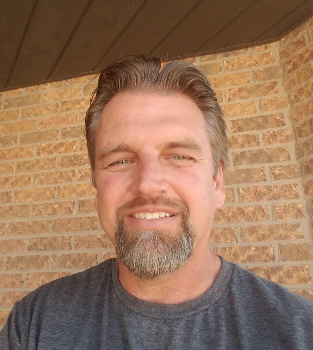 Greenwood head softball coach Scott Robinson
