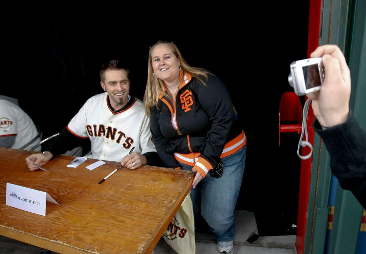 """Giant's Jeremy Affeldt takes a photo with fan, Michele Jensen of Antioch, during the San Francisco Giants 17th annual """"Fan Fest """", on Saturday February 06, 2010, in San Francisco, Calif."""