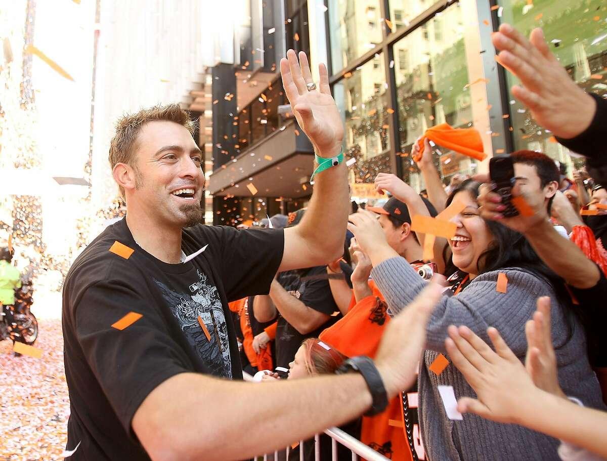 SAN FRANCISCO - NOVEMBER 03: Jeremy Affeldt of the San Francisco Giants high fives fans during the San Francisco Giants victory parade on November 3, 2010 in San Francisco, California. ~~